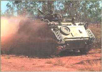 Armoured personnel carrier in action