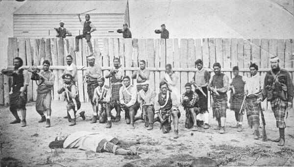Thomas William Porter (right) and pro-Government Maori troops outside a stockade, 1870